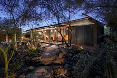 Built on the property of a larger home in Phoenix, Arizona, this small dwelling serves as a guest house for those making a visit to the main home's owners....