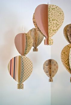 Trail of Ivy Antique 3D Paper Hot Air Balloon Mobile ($65): Hand-crafted from antique papers, this charming mobile can be customized to coordinate with the prominent colors or design elements in your nursery.