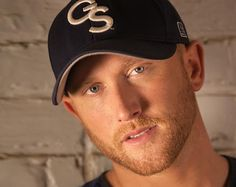 "Watch Cole Swindell Break Down His Hilarious Ode To Pick-Up Lines 'Does It Hurt' Georgia native and Luke Bryan-bestie, Cole Swindell writes some of the most charming tunes in modern country music. Combining pop, and even hip-hop elements with sleek production and a dash of twang, Swindell knows his way around a hook. In addition to performing hits like ""Hope You Get Lonely Tonight"" and ""Ain't Worth The Whiskey,"" he's also co-written songs for Florida Georgia Line and Scotty McCreery."