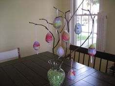 Did this but sprayed the twigs white and the vase has dirt with moss at the top:-) and I used plastic eggs.
