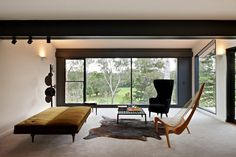 I love how open and inviting the window makes the room feel, and the carpet makes it seem like a luxurious oasis...