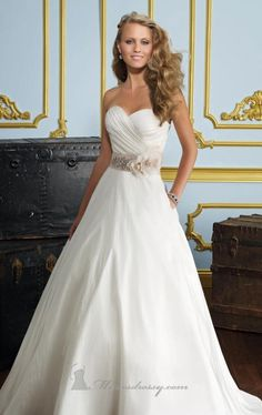 Beautiful. Tasteful, simple sweetheart neck dress with a embroidered belt.