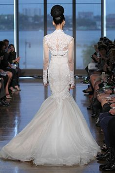 The Ines Di Santo Fall 2014 bridal collection got some many stunning details! We love this mermaid dress with long sleeve boleros.