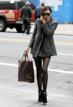 0d3f64013179 Miranda Kerr shows of her legs in sheer black tights