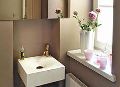 Auch ein Gäste-WC kann schmuck sein. Schenken Sie Ihrem kleinsten Raum mit Farbe, Fliesen, Bildern und Deko persönlichen Charme. So geht's.
