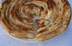 """In Bosnia and neighboring countries phyllo dough (orignally jufka – read yoofkah) is often made for pastries such as pita/burek or baklava. Even though phyllo can be bought at the store or bakery, fresh, homemade phyllo is always the best! In the past it was very desirable for a young woman to know how to make jufka. Often after a girl learned how to make phyllo, family members would jokingly say: """"Well now you CAN get married!"""""""
