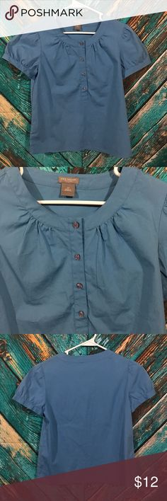 Ann Taylor Blouse Women's 2 Petite Ann Taylor blouse  Women's size 2 petite  Gently used no holes or stains  Blue short sleeve, four buttons at top  97% cotton and 3% spandex  Under arm to under arm 16 inches  length 22 inches Ann Taylor Tops Blouses