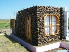 Building a Slipform Stone House from the Ground Up.