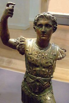 54-68 CE. Statuette of Emperor Nero in the guise of Alexander the Great,  Silver and copper-plating and deliberately patinated black bronze detail over hollow cast bronze. Roman-britain, Suffolk, UK.