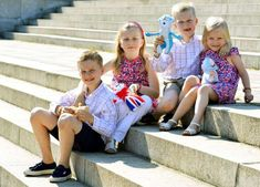 (L - R) Prince Gabriel, Princess Elisabeth, Prince Emmanuel and Princess Eleonore of Belgium pose for photographers in central London ahead of the London 2012 Olympic Games, on July 26, 2012. Belgium - Benoit Doppagne/Pool/Reuters