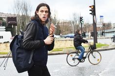 Model Miles McMillan takes a break from NYFW with his Tommy Ton for Club Monaco backpack.