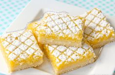 Sweet Coconut and Lime Bars on Buttery Coconut Shortbread Dusted with Powdered Sugar