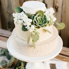 """Surprise! This gorgeous cake shot by TheTomKatStudio for Real California Milkisn't actually cake -- it's cheese. Play up your """"dessert"""" table with something unexpected, then decorate with succulents for a fun, desert feel."""