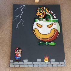 The Misses painted a little design on Mario and Bowser canvas. #perlerbeads #perler #hamabeads #hama #artkal #nabbi #beadsprites #pixelart #pixel #art #nintendo #ninstagram #igersnintendo #mario #bowser #snes #8bit #16bit