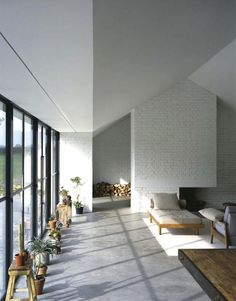 barns-living-rooms-gray-white-brick-walls-chaise-longues-concrete-floors-counter-stools