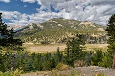 Tim Lumley posted a photo:  McGregor Mountain, elevation 10,486 feet, as seen from Fall River Road looking across the winding Fall River and a rather broad meadow known as the Horseshoe Park area of RMNP.  A 500-foot thick glacier once covered this valley. As the glacier inched along over thousands of years, it scoured out the distinctive U-shaped valley and carried the rock debris downhill. About 15,000 years ago, the glacier began to recede. At the farthest point of the glacier's advance…