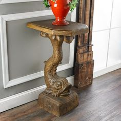 """Vintage Dolphin Fish Pedestal Table This vintage dolphin koi fish pedestal is a grand statement piece for your entryway, dining room, bedroom or bath. Molded in resin, and painted in a golden aged brown finish, this unique accent table is sure to make a splash! (34.5""""Hx15.5""""Wx20.5""""D)"""