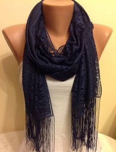 A personal favorite from my Etsy shop https://www.etsy.com/listing/206985998/very-dark-blue-tulle-fringed-scarfblue