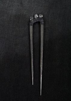 ANU TERA HERKIMER HAIRPIN. Freehand wrought iron piece made by Tarvo Porroson. 3 herkimer diamonds wrapped in goatskin and waxed thread