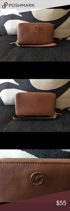"""Michael Kors - Pebble Brown Wristlet/Wallet! 💯% Authentic Michael Kors Writlet/Wallet! In Pebble Brown Color! In Great Condition! Dimension: 6""""W x 4""""H x 3/4""""D! Reasonable Offers Welcomel! Happy Poshing. Michael Kors Bags Wallets"""