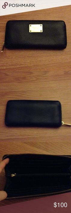 Micheal Kors leather wallet Black leather wallet. Great quality. Hardly ever used!! Michael Kors Bags Wallets