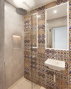 This En-Suite in of the guest bedrooms stands out for the vibrant Moroccan style tiles used along the main wall. This contrasts to the concrete effect finish on the other walls within this small space. Bathroom Tile Designs, Bathroom Interior Design, Toilet Tiles Design, Morrocan House, Moroccan Tile Bathroom, Small Shower Room, Riad Marrakech, Mediterranean Bathroom, Moroccan Interiors