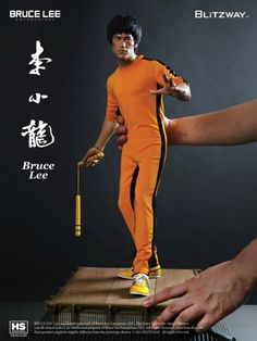 AMAZING sculpt of a BRUCE LEE collectable doll.  BEAUTIFUL!  The detail, and realism is fantastic.    HotToys.com / Sideshow.com