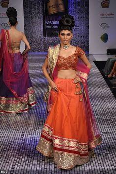 A model showcases a creation by designer Ramesh Dembla at Bangalore Fashion Week 2013