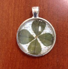 The clovers are searched, picked and pressed by myself. The pendant has a meaning of luck or lucky dictionary printout as a background in