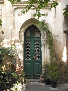 Tall, slender, teal, double door. What architecture style is this? Morroccan, Indian?
