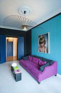 Blue wall and purple sofa
