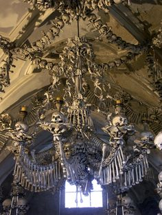 Elaborate chandeliers made of human bones decorate the ceilings of the Sedlec Ossuary in the Czech Republic.