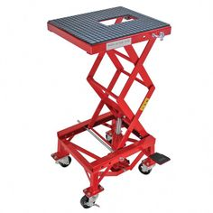 Extreme Max Hydraulic Motorcycle Lift Table at Lowe's. Lifting up to 300 lbs., the Hydraulic Motorcycle Lift Table is perfect for tinkering on your dirt bike or small motorcycle. Set your bike on the table, Motorcycle Lift Table, Bike Lift, Motorcycle Bike, Small Motorcycles, Lifted Cars, Lifted Chevy, Welding Table, Bike Rack, Bike Accessories