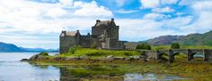 Traveling through the highlands of scotland, taking in the beautiful scenery and medieval castles