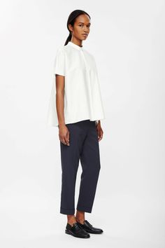 Designed to fall loosely on the body, this square-cut shirt is made from lightweight cotton poplin. Flaring towards the hem, it has a hidden button fastening, stitch detail placket and dropped kimono sleeves.