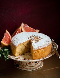 Desserts for Breakfast: Grapefruit Rosemary Olive Oil Cake - reduced the syrup even more and served with grapefruit whipped-cream (used excess syrup) and berries