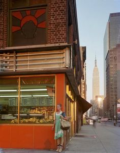 Joel Meyerowitz, Young Dancer,1978, View of Empire State Building, Manhattan, New York City.