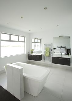 Not just twin basins but twin vanities are placed in this bathroom, making the view symmetrical from bed.