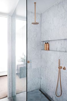Love this built-in shelf in the shower as an alternative to a niche | modern marble shower with hexagon floor tile