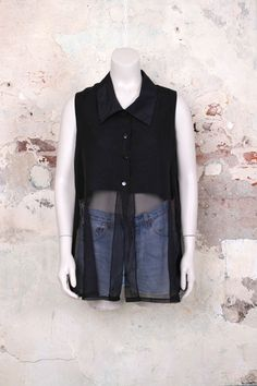Zwarte mouwloze blouse top met transparante onderkant