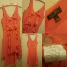 Gorgeous Coral Dress This is super cute, in great used condition. Dress up or dress down. Very light and flowy. Missing small belt. Lined. 60% rayon, 40% polyester. Lily Rose Dresses
