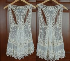 Pretty feminine white lace tops~ great with pastel or bright colored camisole underneath*  own it! :)