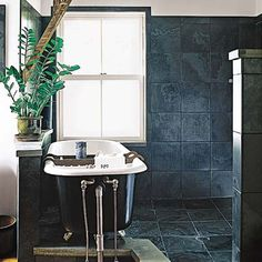 For a dramatic, monochromatic effect, tile bathroom walls with the same 12x12s used on the floor. Dark gray ceramic tiles have a look similar to the soapstone squares shown here but cost 25 percent less and offer more traction under wet feet. | Photo: Aimee Herring | thisoldhouse.com