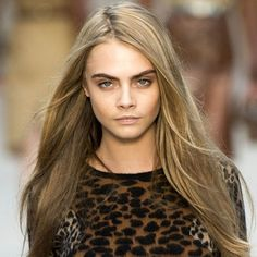 Cara Delevingne with long caramel highlights