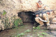 Fusilier Scott Clarke , 19, finds a taliban escape tunnel after the battle for Yatimchie in Helman Afganistan (Pic:Roger Allen)