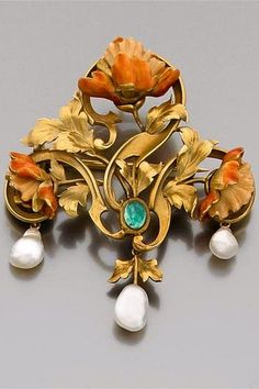 A natural pearl, emerald and gold brooch by VEVER.