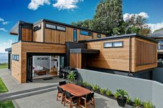 Wood-clad exterior with powder-coated black metal framing