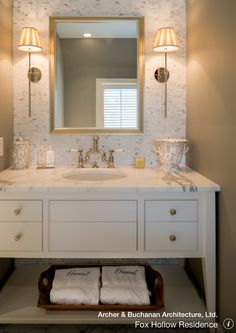 Great use of warm beige walls and beautiful tile above the sink.