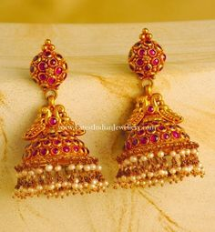 latest ruby jhumka earrings in 22 kt gold that will suit anyone in any occasion. The gorgeous gold earrings with pearl drops and completely studded with pink spinal rubies Indian Jewellery Design, Indian Jewelry, Jewelry Design, Kerala Jewellery, Antique Jewellery, Ruby Jewelry, Bridal Jewelry, Gold Jewelry, Jhumka Designs