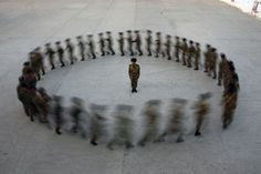 A commander watches as recruits of paramilitary police run in a circle during a training at a military base in Hami, Xinjiang Uighur Autonomous Region, China, December 29, 2010.